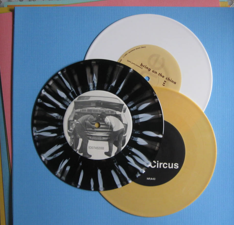 opaque yellow white black and white colored record vinyl 7 inch