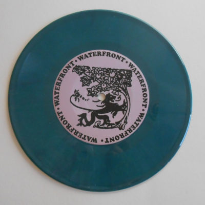 Teal green colored record opaque vinyl 7 inch record